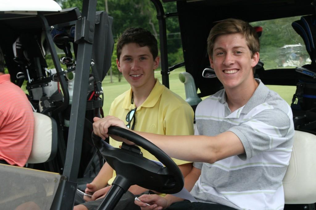 boys in golf cart